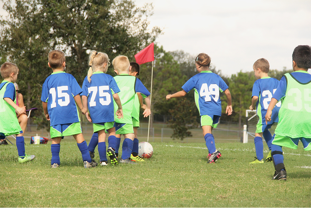 Photograph of children playing soccer at the Rolling Acres Sports Complex.